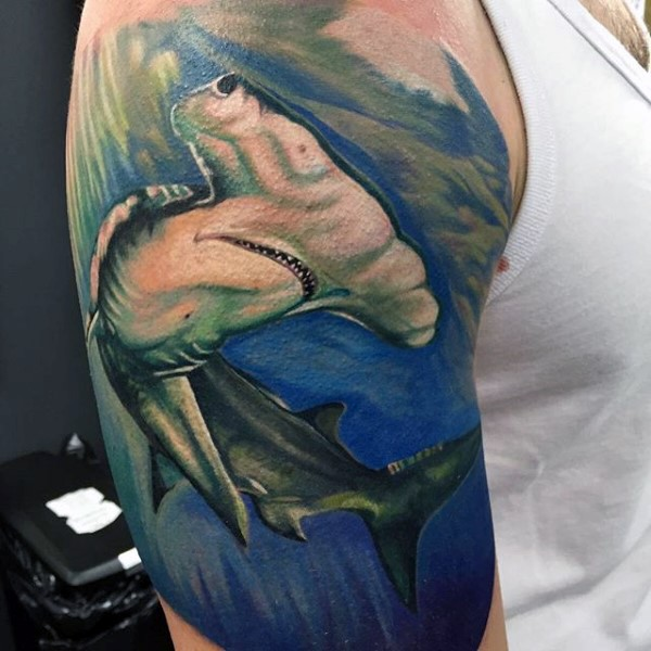 Real photo like colored shoulder tattoo of hammerhead shark