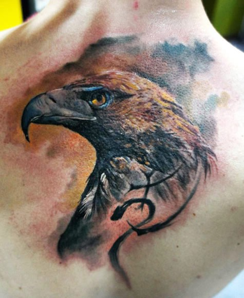 Realism style colored back tattoo of eagle with symbol