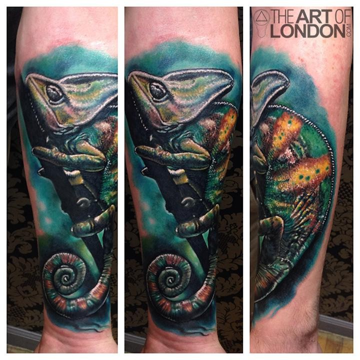 Realism style colored forearm tattoo of cool chameleon