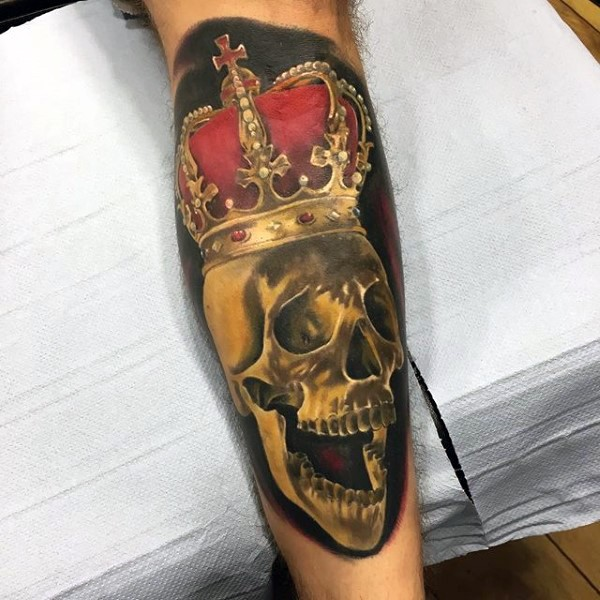 Realism style colored leg tattoo of human skull with big crown