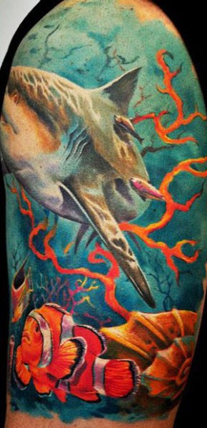Realism style colored shoulder tattoo of underwater shark