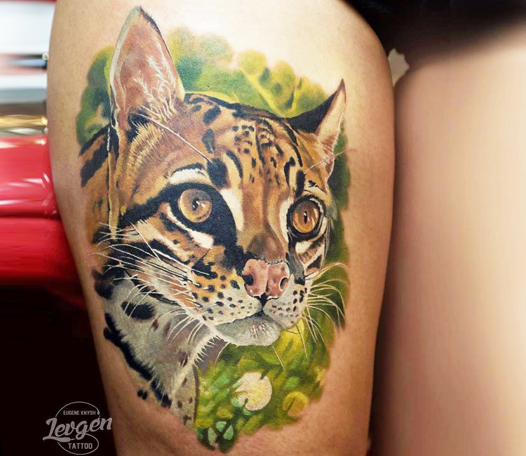 Realism style colored thigh tattoo of leopard head