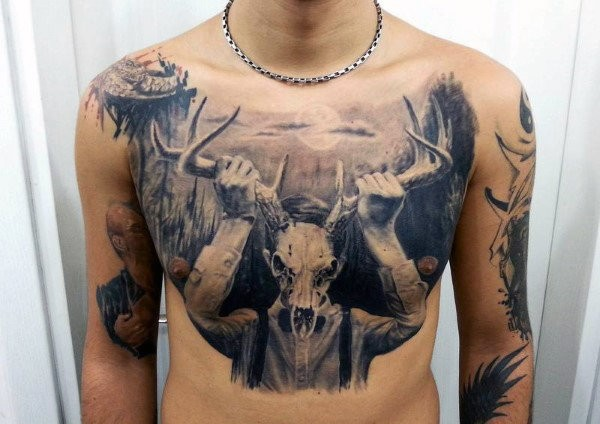 Realistic black ink chest tattoo of human with animal skull and horns