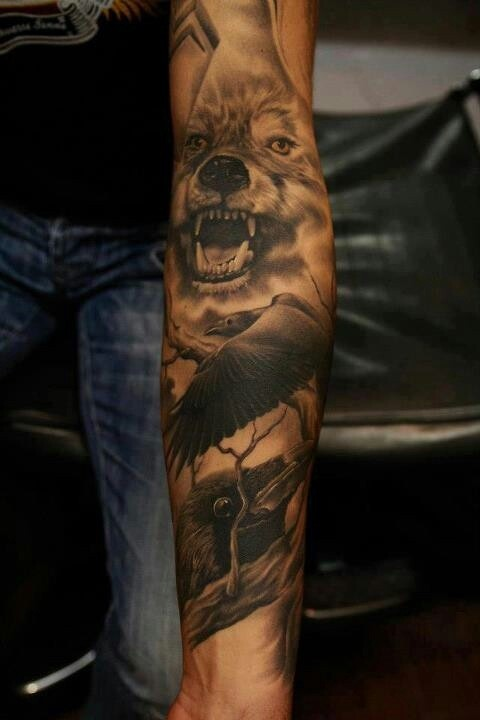 Realistic crow and wolf tattoo on full sleeve