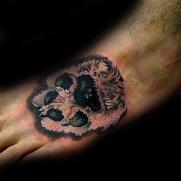 Realistic looking colored foot tattoo of dog paw print