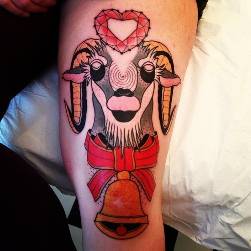 Red abstract ram tattoo on arm
