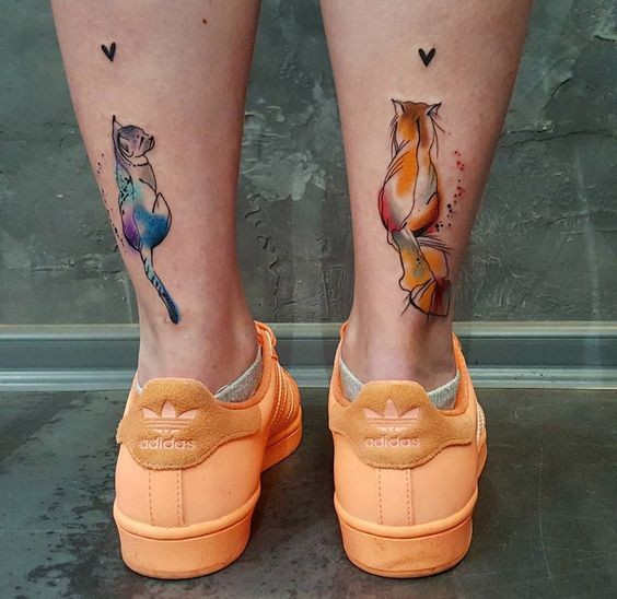 Romantic looking for girls tattoo of cat couple with hearts
