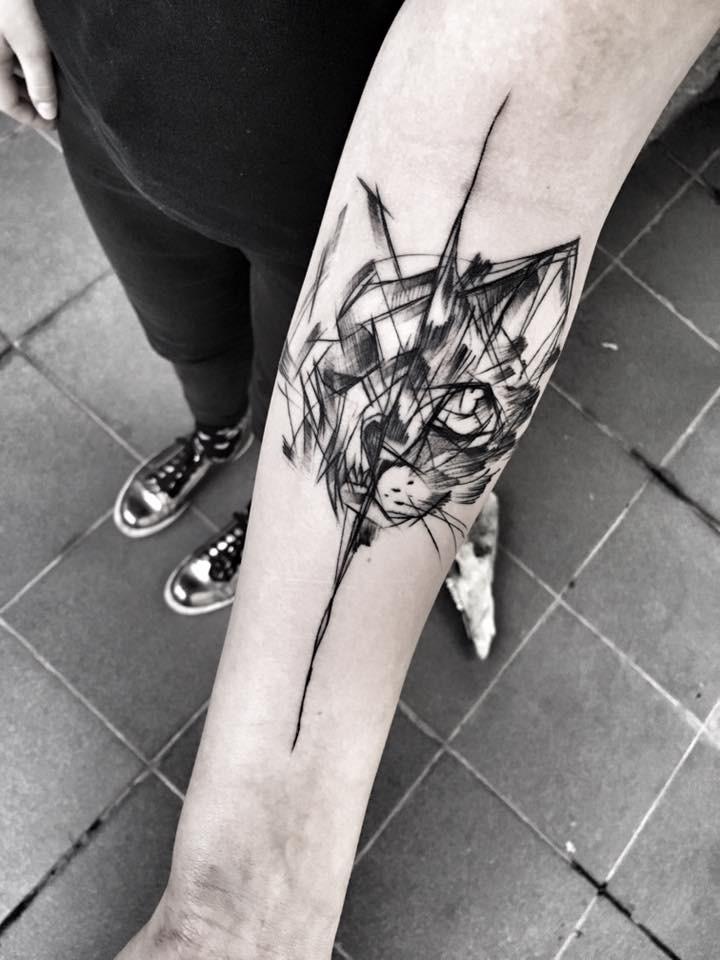 Separated black ink forearm tattoo of cat head by Inez Janiak