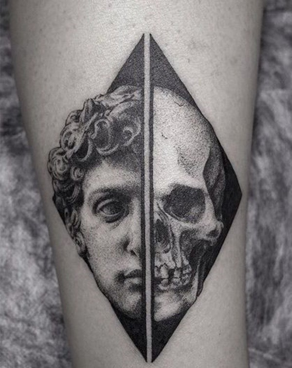 Separated black ink leg tattoo of half human skull with antic statue