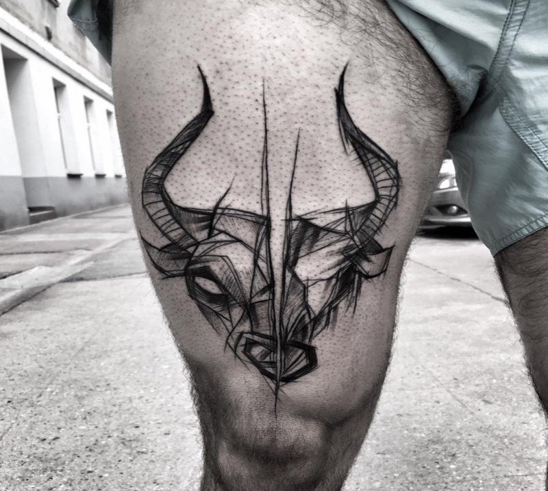 Separated blackwork style thigh tattoo of various animal skull