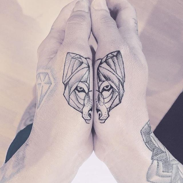 Separated dot style hand tattoo of wolf head