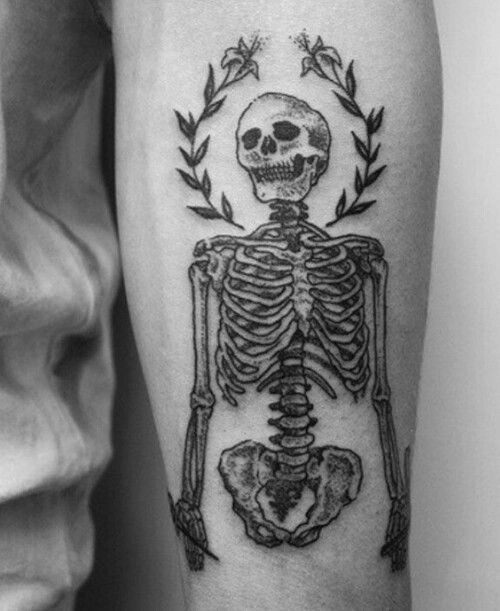 Simple blackwork style arm tattoo of human skeleton with flowers