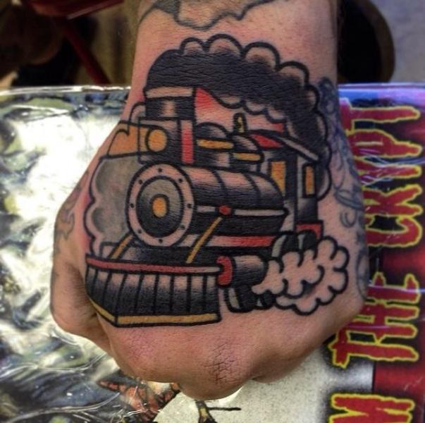 Simple carelessly painted old school train tattoo on fist