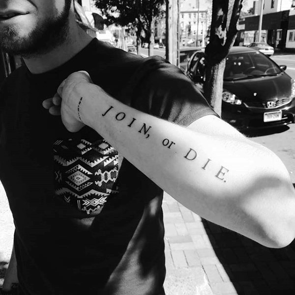 Simple classic join or die lettering tattoo on arm