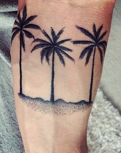 Simple deigned little black ink palm trees tattoo on arm
