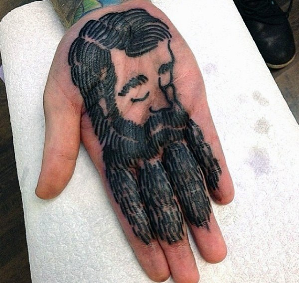 Simple design black ink man's portrait with beard tattoo on hand palm and fingers