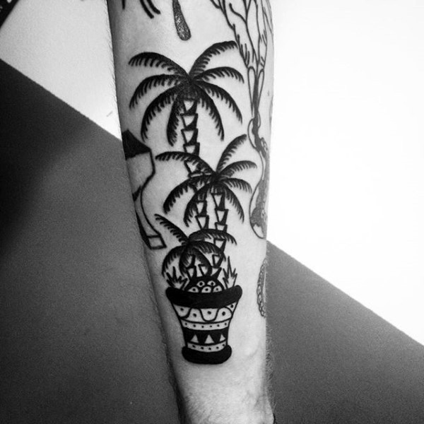 Simple homemade like black ink palm tree in pot tattoo no arm