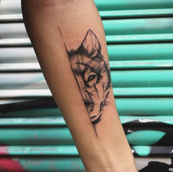 Simple linework style black ink forearm tattoo of wolf head part