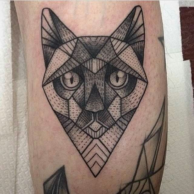 Simple looking black ink leg tattoo of dot style cat