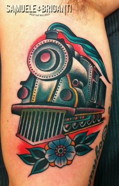 Simple old school biceps tattoo of small train with flowers