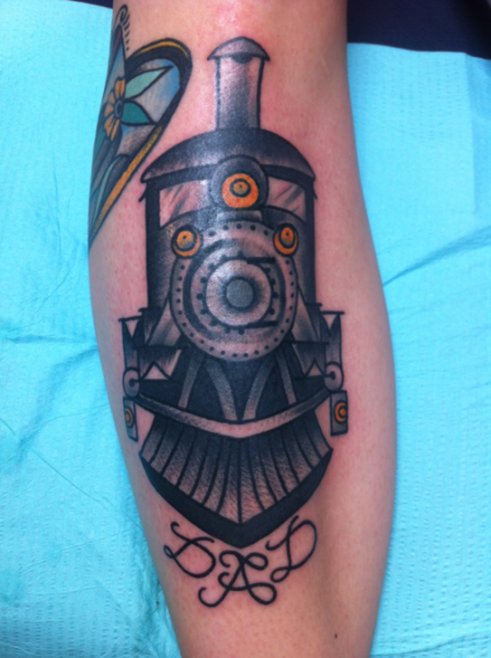 Simple old school memorial tattoo of steam train and lettering