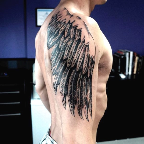 Simple painted black and white wing tattoo on shoulder zone