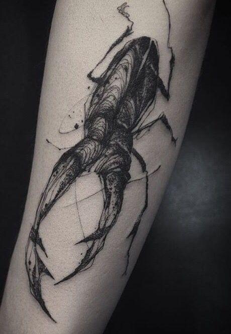 Sketch style black ink forearm tattoo of big bug