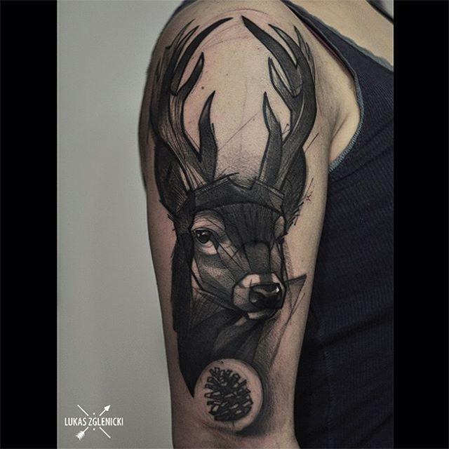 Sketch style black ink shoulder tattoo of deer head