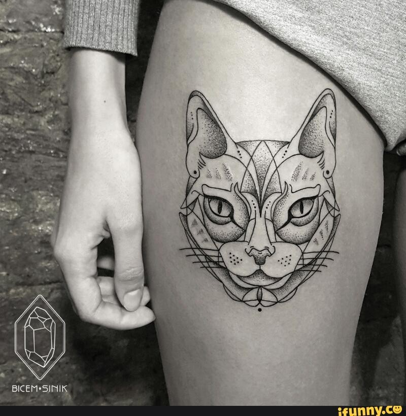 Sketch style black ink thigh tattoo of cat head
