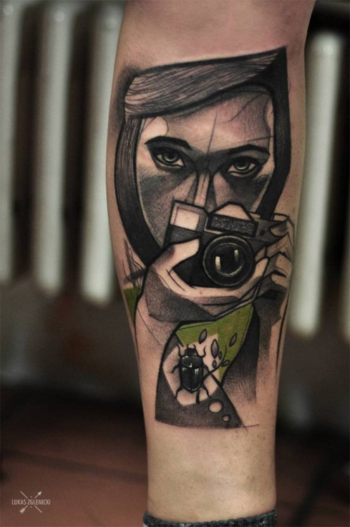 Sketch style colored arm tattoo of woman with camera and bug