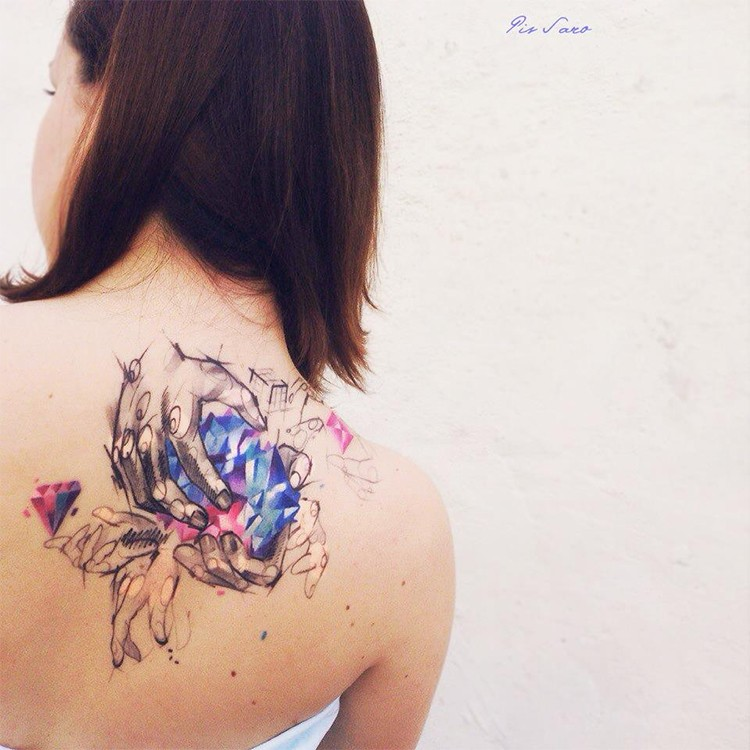 Sketch style colored back tattoo of human hands with diamond