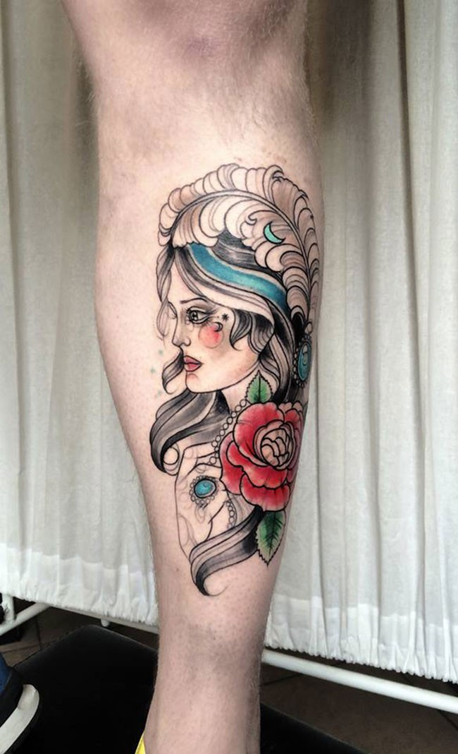 Sketch style colored leg tattoo of nice woman with feather and rose