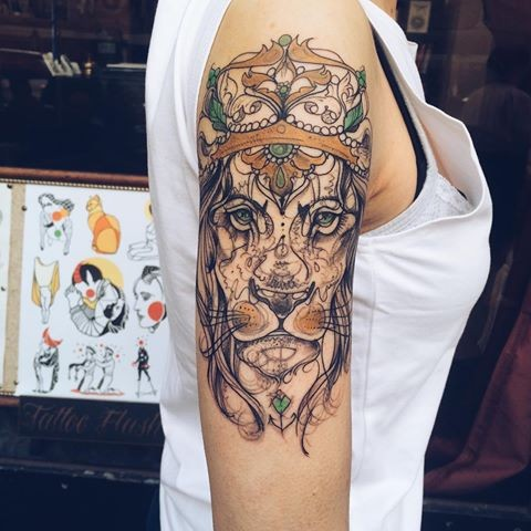 Sketch style colored shoulder tattoo of beautiful lion with crown