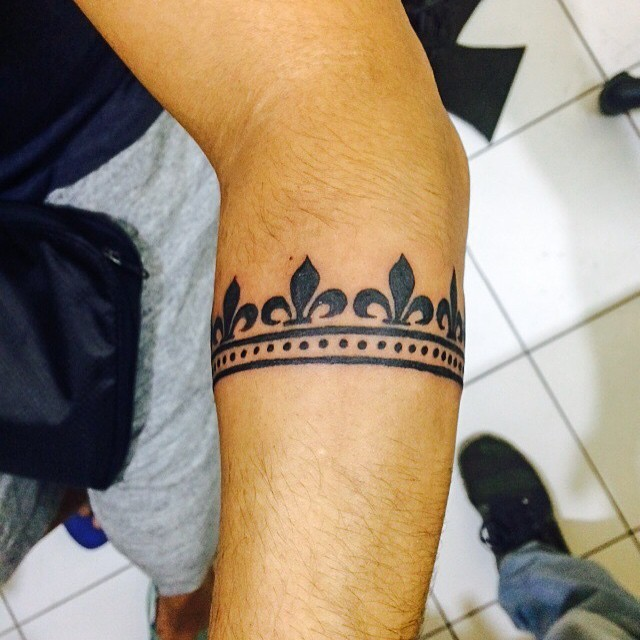 Small blackwork style arm tattoo of cool ornament