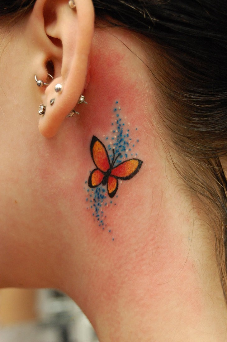 Small butterfly tattoo behind ear