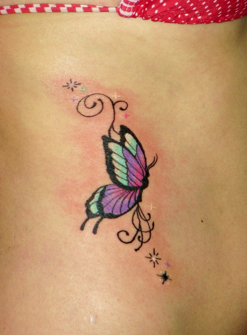 Small butterfly tattoo with stars on ribs
