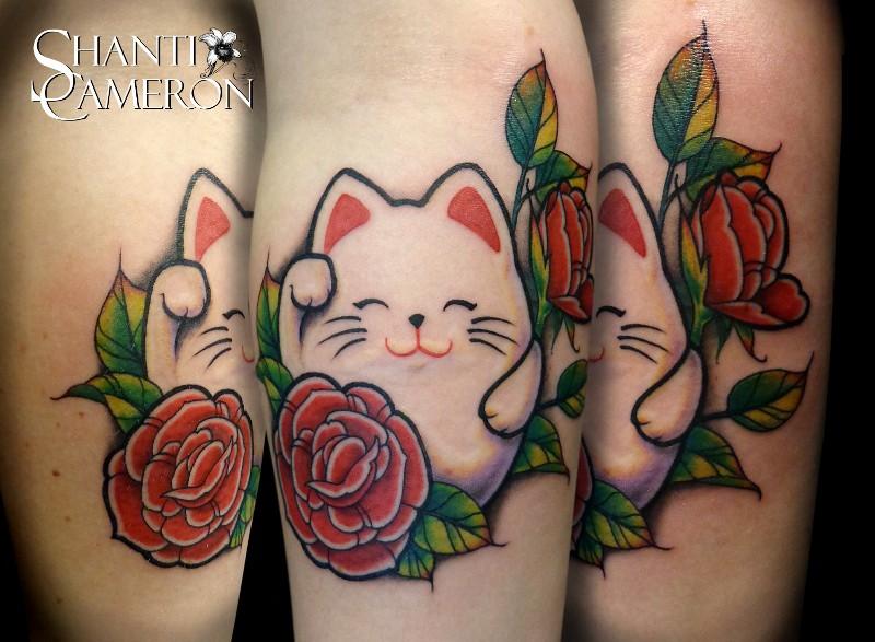 Small cartoon style colored leg tattoo of cute maneki neko japanese lucky cat with rose