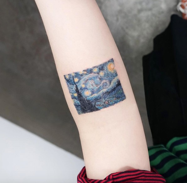 Small cool looking colored arm tattoo of castle with night sky and stars