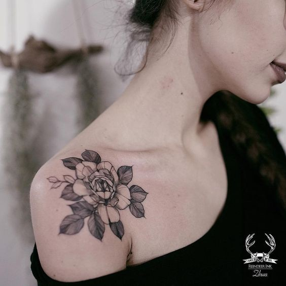 Small cute looking by Zihwa tattoo on shoulder of rose