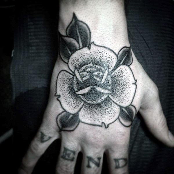 Small dotwork style hand tattoo of cute flower