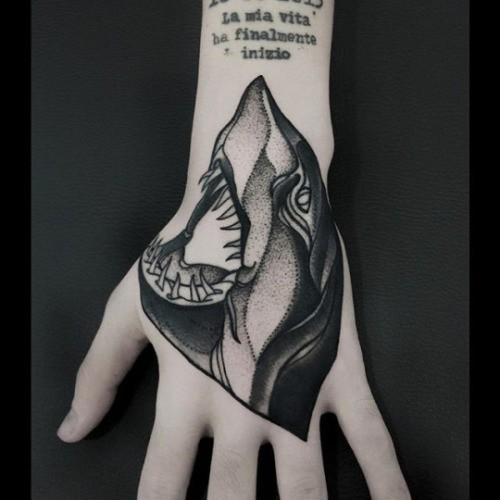 Small dotwork style painted by Michele Zingales hand tattoo of shark head