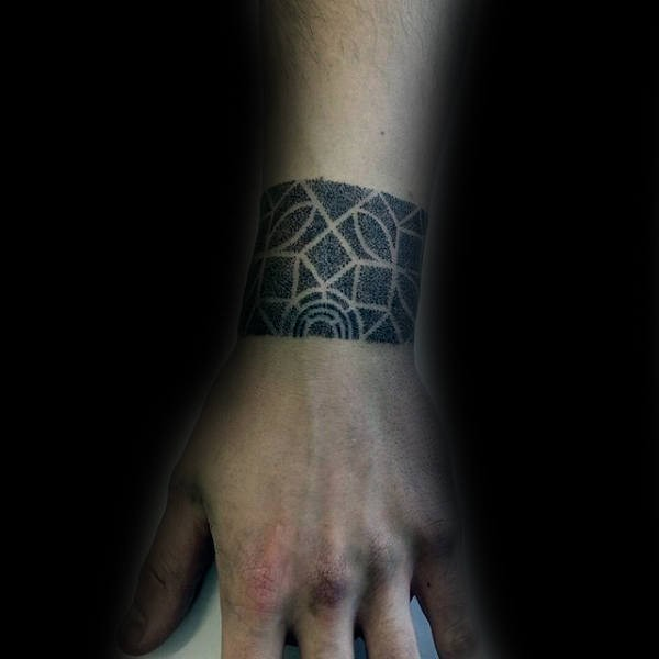 Small dotwork style tattoo of simple wrist band