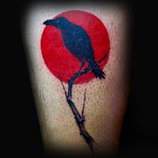 Small illustrative style crow with tree branch tattoo