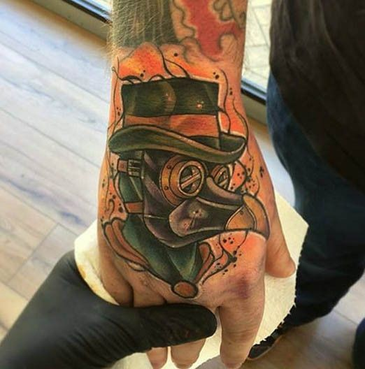 Small old school style hand tattoo of plague doctor