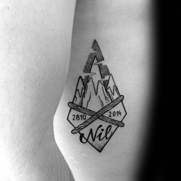 Small stippling style ancient arrow head with lettering and date