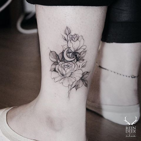 Small Zihwa typical ankle tattoo of flowers with moon