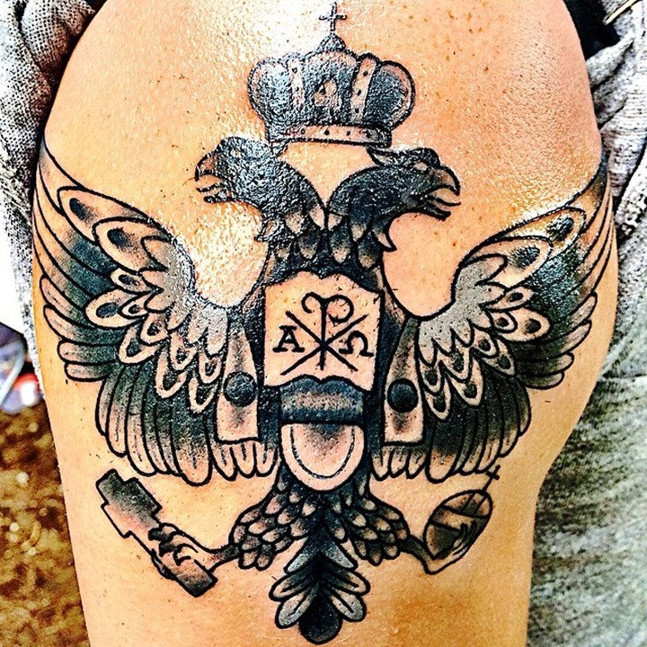 Spectacular colored big eagle with two heads family crest style tattoo on shoulder stylized with Chirho
