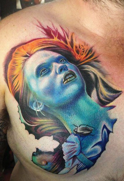 Spectacular looking colored chest tattoo of fantasy woman with bug