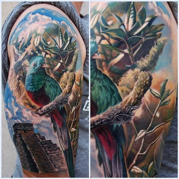 Spectacular multicolored shoulder tattoo of Mayan pyramid with parrot