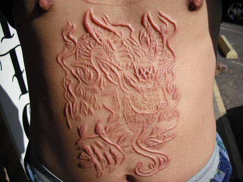 Spooky demon skin scarification on stomach